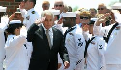 Secretary of Defense Chuck Hagel arrives for the change of command and retirement ceremony Monday, May 5, 2014, in Mascoutah, Ill. Defense Secretary Chuck Hagel and Joint Chiefs of Staff Chairman Martin Dempsey attended Monday's ceremony marking Gen. Paul Selva's transition to lead the U.S. Transportation Command. The command is based at Scott Air Force Base. (AP Photo/Belleville News-Democrat, Derik Holtmann)