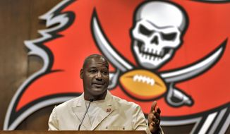 Former Tampa Bay Buccaneers linebacker Derrick Brooks gestures during a news conference Tuesday, May 6, 2014, in Tampa, Fla., after it was announced that he would be inducted into the team's Ring of Honor. Brooks played 14 season with the Buccaneers. (AP Photo/Chris O'Meara)