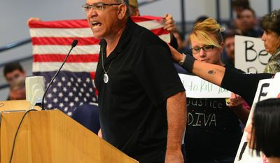 Mike Gomez, whose son Alan Gomez,  was fatally shot by an APD officer in 2011 expresses his frustration to the City Council members during the council meeting, Monday May 5, 2014, in Albuquerque, N. M. (AP Photo/The Albuquerque Journal, Bob Brawdy)
