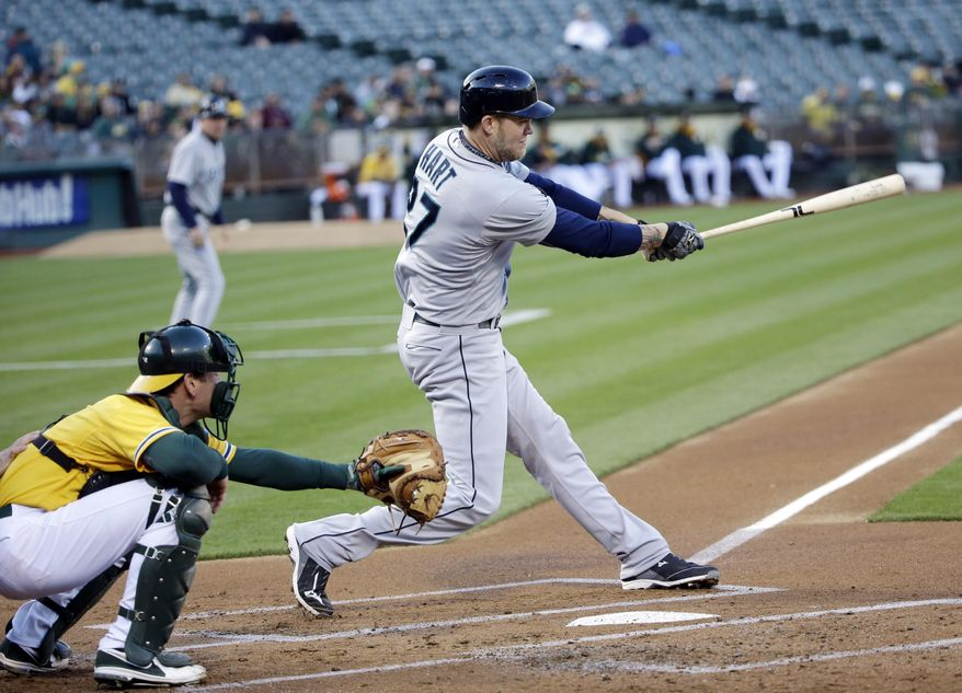 Seattle Mariners' Corey Hart drives in a run with a single against the Oakland Athletics during the first inning of a baseball game on Monday, May 5, 2014, in Oakland, Calif. (AP Photo/Marcio Jose Sanchez)