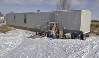 FILE -This Feb. 5, 2014 file photo shows a mobile home in Fort Yates, N.D., where Debbie Dogskin was found dead in an unheated home during a propane crisis on the Standing Rock Sioux Reservation. An autopsy concluded that the 61-year-old woman died of hypothermia. (AP Photo/The Bismarck Tribune, Tom Stromme, File)