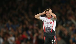 Liverpool's Joe Allen reacts at the end of the English Premier League soccer match between Crystal Palace and Liverpool at Selhurst Park stadium in London, Monday, May 5, 2014.The game ended in a 3-3 draw. (AP Photo/Alastair Grant)