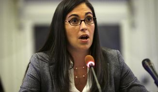 Former aide to Gov. Chris Christie, Christina Renna, testifies  in Trenton, N.J., Tuesday, May 6, 2014, before New Jersey lawmakers probing the George Washington Bridge lane closures scandal. A legislative committee is investigating who was behind the politically motivated order to close lanes leading to the bridge last September. (AP Photo/Mel Evans)