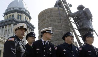 Members of the Hinsdale Fire Department participate in the 21st Annual Illinois Fallen Firefighter Memorial and Firefighter Medal of Honor Awards Ceremony at the Illinois State Capitol Tuesday, May 6, 2014, in Springfield, Ill. (AP Photo/Seth Perlman)