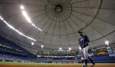 Tampa Bay Rays relief pitcher Josh Lueke walks to the dugout after some of the power went out at Tropicana Field during the eighth inning of a baseball game against the Baltimore Orioles, Tuesday, May 6, 2014, in St. Petersburg, Fla. (AP Photo/Chris O'Meara)