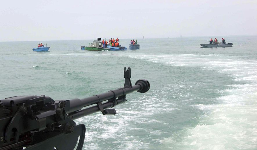 ** FILE ** In this file photo taken on April 3, 2006, members of Iran's elite Revolutionary Guard attend  maneuvers in the Persian Gulf. (AP Photo/IRNA, File)