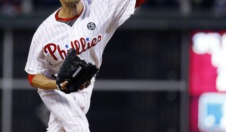 Philadelphia Phillies' Cole Hamels pitches during the fourth inning of a baseball game against the Toronto Blue Jays, Tuesday, May 6, 2014, in Philadelphia. (AP Photo/Matt Slocum)