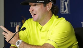 Bubba Watson answers questions at a news conference after a practice round for The Players championship golf tournament at TPC Sawgrass in Ponte Vedra Beach, Fla., Tuesday, May 6, 2014. (AP Photo/John Raoux)