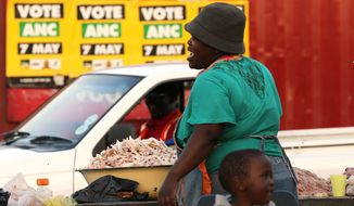 A woman sells chicken feet at a market in Atteridgeville, west of Pretoria. South African President Jacob Zuma said Monday that he anticipates an election victory this week. (Associated Press)