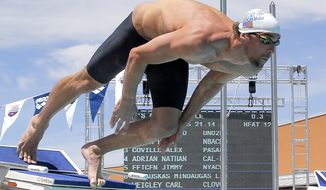FILE - In this Friday, April 25, 2014, file photo, Michael Phelps starts the 50-meter freestyle preliminary heat during the Arena Grand Prix swim event, in Mesa, Ariz. Next up for Michael Phelps' comeback: Two events that produced Olympic gold. Phelps has entered the 100-meter butterfly and the 200 freestyle at the Charlotte Grand Prix meet in North Carolina next week, his coach, Bob Bowman, told The Associated Press on Monday, May 5, 2014. (AP Photo/Matt York, File)
