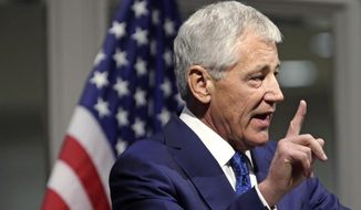 U.S. Defense Secretary Chuck Hagel speaks during an event hosted by The Chicago Council on Global Affairs, Tuesday, May 6, 2014, in Chicago. Hagel's speech is his third on new strategic priorities as the armed forces pivot from a 13-year war footing and come under enormous budgetary constraints. (AP Photo/M. Spencer Green)