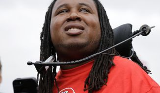 "ADDS UPDATE FROM SCHOOL - FILE - In this Sept. 14, 2013, file photo, former Rutgers football player Eric LeGrand looks up at the stands during ceremony where his jersey No. 52 was retired at halftime of an NCAA college football game against Eastern Michigan in Piscataway, N.J.  LeGrand, whose recovery from a paralyzing injury suffered during a game has become a unifying and inspirational story for the school, was announced Tuesday, MAY 6, 2014, as one of its commencement speakers, a day after he said the offer to do so was rescinded ""for political reasons."" The announcement from Rutgers President Robert Barchi, who said there was a ""miscommunication"" about the speeches, is the latest development in a strange saga surrounding the May 18 ceremony. (AP Photo/Mel Evans, File)"