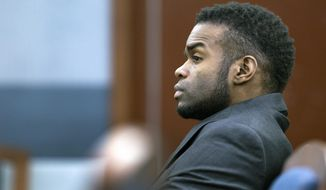 Jason Omar Griffith, the man accused of killing dancer Debora Flores Narvaez, appears in court during jury selection, at the Regional Justice Center in Las Vegas Monday, May 5, 2014. Lawyers and a Nevada judge began selecting a jury Monday to hear the murder case against Jason Omar Griffith, who is accused of strangling Deborah Flores Narvaez during a heated argument and dismembering her body.  (AP Photo/Las Vegas Sun, Steve Marcus)