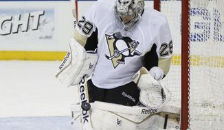 Pittsburgh Penguins goalie Marc-Andre Fleury (29) makes a save in the second period of their second-round NHL Stanley Cup hockey playoff game against the New York Rangers at Madison Square Garden in New York, Monday, May5, 2014.  (AP Photo/Kathy Willens)