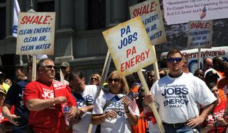 Members of the Marcellus Shale Coalition rally on the steps of the Pennsylvania state Capitol, Tuesday, May 6, 2014, in Harrisburg, Pa.  The event is intended to let legislators and the public know that a diverse group of people support the natural gas boom that began about six years ago. (AP Photo/Bradley C Bower)