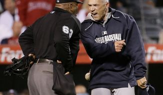 New York Yankees manager Joe Girardi, right, argues a strike call against Brett Gardner with home plate umpire Laz Diaz during the eighth inning of a baseball game against the Los Angeles Angels in Anaheim, Calif., Monday, May 5, 2014. (AP Photo/Chris Carlson)