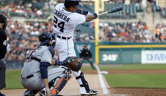 Detroit Tigers' Miguel Cabrera hits a solo-home run off Houston Astros pitcher Brett Oberholtzer in the first inning of a baseball game in Detroit, Tuesday, May 6, 2014. (AP Photo/Paul Sancya)