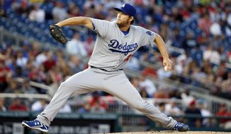 Los Angeles Dodgers pitcher Clayton Kershaw (22) throws during the third inning of a baseball game against the Washington Nationals at Nationals Park, Tuesday, May 6, 2014, in Washington. (AP Photo/Alex Brandon)