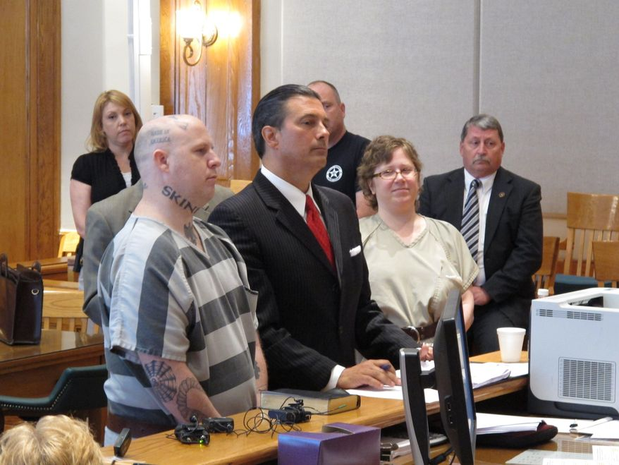 From left, Jeremy Moody, lawyer Harry Dest and Christine Moody appear before a judge as the Moody's get ready to plead guilty to murder on Tuesday, May 6, 2014, in Union, S.C. Prosecutors said the husband and wife killed Charles Parker in his home in July 2013 because he was a sex offender and his wife Gretchen Parker because she was there. (AP Photo/Jeffrey Collins)