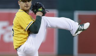Oakland Athletics starting pitcher Scott Kazmir throws to the Seattle Mariners during the first inning of a baseball game on Monday, May 5, 2014, in Oakland, Calif. (AP Photo/Marcio Jose Sanchez)