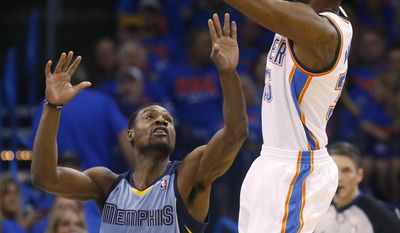 Oklahoma City Thunder forward Kevin Durant, right, shoots over Memphis Grizzlies guard Tony Allen (9) in the first quarter of Game 7 of an opening-round NBA basketball playoff series in Oklahoma City, Saturday, May 3, 2014. (AP Photo/Sue Ogrocki)