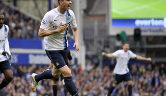 Manchester City's Edin Dzeko celebrates after he scored the second goal of the game for his side during their English Premier League soccer match against Everton at Goodison Park in Liverpool, England, Saturday May 3, 2014. (AP Photo/Clint Hughes)