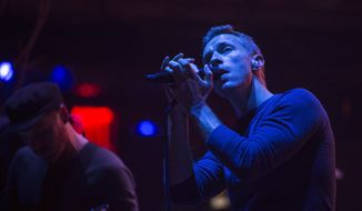 Chris Martin, right, and Jonny Buckland from the band Coldplay perform at the Beacon Theatre on Monday, May 5, 2014, in New York. (Photo by Drew Gurian/Invision/AP)
