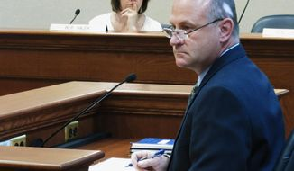 Tony Leif, director of the Division of Wildlife, speaks to the legislative Rules Review Committee on May 6, 2014, at the Capitol building in Pierre, S.D. He says refuges are not as important for wildlife management as once thought. (AP Photo/Nora Hertel)