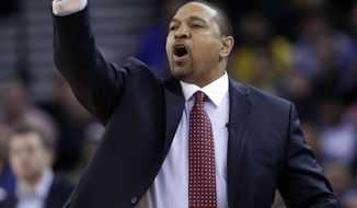 FILE - In this Thursday, Feb. 6, 2014, Golden State Warriors head coach Mark Jackson instructs his team during the first half of an NBA basketball game against the Chicago Bulls in Oakland, Calif. The Warriors fired Jackson on Tuesday, May 6, 2014. (AP Photo/Marcio Jose Sanchez, File)