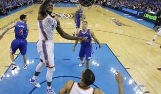 Oklahoma City Thunder forward Serge Ibaka (9) dunks in front of Los Angeles Clippers forward Blake Griffin (32) in the first quarter of Game 1 of the Western Conference semifinal NBA basketball playoff series in Oklahoma City, Monday, May 5, 2014. (AP Photo/Sue Ogrocki)