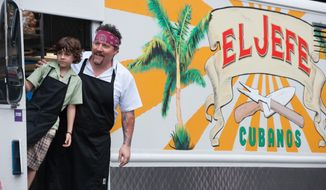 """This image released by Open Road Films shows Emjay Anthony, left, and Jon Favreau in a scene from """"Chef."""" (AP Photo/Open Road Films, Merrick Morton)"""