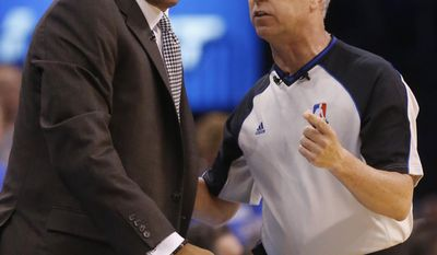 Los Angeles Clippers head coach Doc Rivers, left, reacts to a call by official Eric Lewis, right, in the first quarter of Game 1 of the Western Conference semifinal NBA basketball playoff series against the Oklahoma City Thunder in Oklahoma City, Monday, May 5, 2014. (AP Photo/Sue Ogrocki)