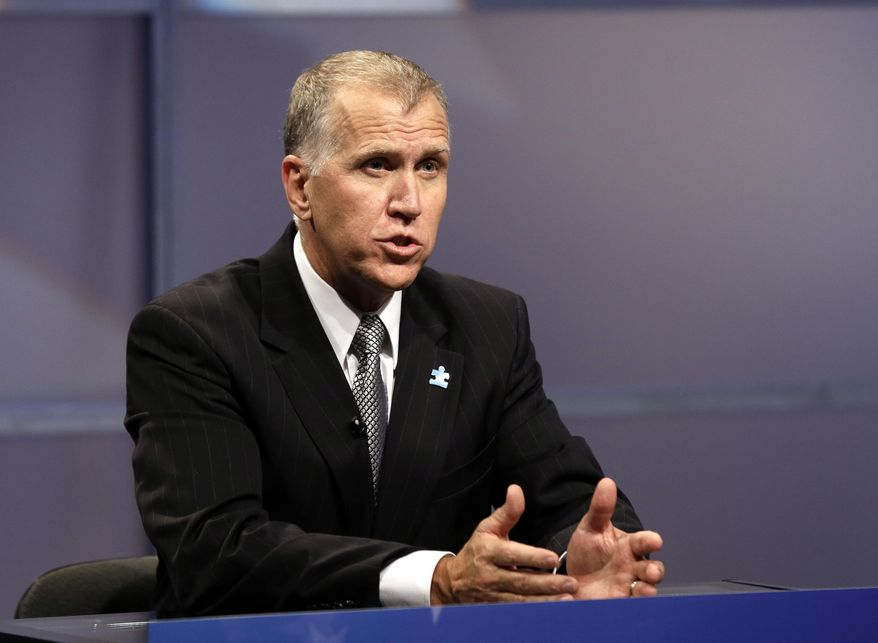 FILE - In this April 23, 2014, file photo, Republican senatorial candidate Thom Tillis responds during a televised debate at WRAL television studios in Raleigh, N.C.  The struggle for control of the Republican Party is getting an early voter test in North Carolina, where former presidential nominee Mitt Romney and tea party favorite Rand Paul on Monday, May 5 pushed their own candidates for the right to challenge Democratic Sen. Kay Hagan in November.(AP Photo/Gerry Broome, Pool)