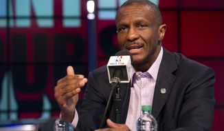 Toronto Raptors head coach Dwane Casey addresses the media during an NBA basketball news conference, Tuesday, May 6, 2014. Casey has agreed to a three-year contract extension after Toronto won a franchise-record 48 games this season. (AP Photo/The Canadian Press, Galit Rodan)
