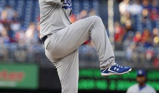 Los Angeles Dodgers starting pitcher Clayton Kershaw throws during the first inning of a baseball game against the Washington Nationals at Nationals Park, Tuesday, May 6, 2014, in Washington. (AP Photo/Alex Brandon)