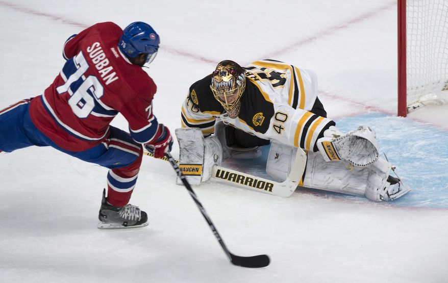 Montreal Canadiens' P.K. Subban, left, scores past Boston Bruins goalie Tuukka Rask during the first period in Game 3 of an NHL hockey Stanley Cup playoff series, Tuesday, May 6, 2014, in Montreal. (AP Photo/The Canadian Press, Paul Chiasson)
