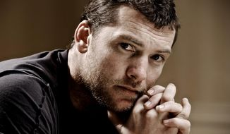 "FILE - In this March 21, 2010 file photo, actor Sam Worthington, poses for a portrait in Beverly Hills, Calif. The ""Avatar"" actor is on track to get his New York assault case dismissed after being accused of punching a photographer, who also was arrested. The Australian actor was due in court Thursday, May 8, 2014. (AP Photo/Kristian Dowling, file)"