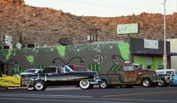 This Sept. 17, 2011 photo provided by Jim Hinckley shows a display of classic cars on Beale Street in Kingman, Ariz. The city is preparing to host an international Route 66 festival in August 2014 featuring classic cars, drive-in movies and concerts. (AP Photo/Courtesy of Jim Hinckley)