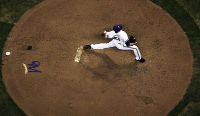Milwaukee Brewers relief pitcher Wei-Chung Wang throws during the ninth inning of a baseball game against the Arizona Diamondbacks, Tuesday, May 6, 2014, in Milwaukee. (AP Photo/Morry Gash)
