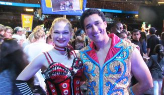 In this undated family photo, Samantha Pitard, left, poses for a photo with Andrey Medeiros. Pitard was one of eight acrobats performing a hair-hanging stunt on Sunday, May 4, 2014, during a Ringling Bros. and Barnum & Bailey circus when a clip at the top of the chandelier-like apparatus snapped. Pitard was the first of the acrobats to be released from the hospital. (AP Photo/Wayne T. Pitard)