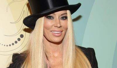 **FILE** Former adult film star Jenna Jameson arrives at Perez Hilton's 34th Birthday and Mad Hatter's Ball on March 24, 2012, at Siren Studios in Los Angeles. (Associated Press/Donald Trail for Perez Hilton)