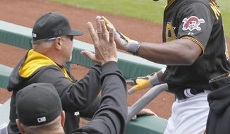 Pittsburgh Pirates' Andrew McCutchen, right, is greeted by teammates after scoring in the first inning of the baseball game against the San Francisco Giants on Wednesday, May 7, 2014, in Pittsburgh. (AP Photo/Keith Srakocic)