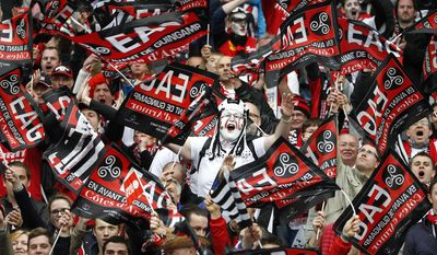 10ThingstoSeeSports -  Guingamp supporters wave flags and chant slogans in the stands of the Stade de France, before the start of the French Cup final match between Guingamp and Rennes at the Stade de France Stadium, in Saint Denis, North of Paris, Saturday, May 3, 2014. (AP Photo/Remy de la Mauviniere, File)