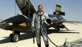 FILE - This 1967 file image provided by NASA shows research pilot Bill Dana in front of the X-15 on the dry lake bed at the Dryden Flight Research Center at Edwards Air Force Base, Calif. Dana, the famed research test pilot who flew the X-15 rocket plane and other pioneering aircraft, died Tuesday, May 6, 2014. He was 83. (AP Photo/NASA, File)