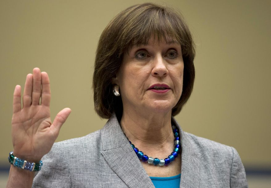 FILE - In this May 22, 2013, file photo, then-IRS official Lois Lerner is sworn in on Capitol Hill in Washington, before the House Oversight Committee hearing to investigate the extra scrutiny IRS gave to tea party and other conservative groups that applied for tax-exempt status.  The House is preparing to vote May 7, on holding Lerner  in contempt of Congress for refusing to testify at a pair of committee hearings about her role in the agency's tea party controversy. (AP Photo/Carolyn Kaster, File)