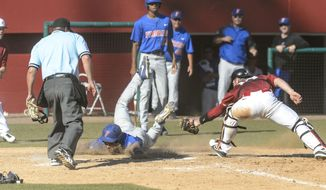 Florida's Richie Martin, third from left, takes advantage of a rundown between first and second and dives safely into home ahead of the throw to Alabama catcher Wade Wass, right, during an NCAA college baseball game on Sunday, May 4, 2014, in Tuscaloosa, Ala. (AP Photo/AL.com, Vasha Hunt) MAGAZINES OUT