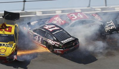 10ThingstoSeeSports - Kurt Busch (41), Joey Logano (22), David Ragan (34) and Michael McDowell (95) collide in Turn 4 during the NASCAR Aaron's 499 Sprint Cup series auto race at Talladega Superspeedway, Sunday, May 4, 2014, in Talladega, Ala. (AP Photo/Skip Williams, File)