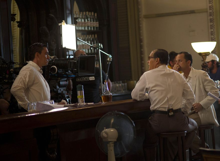"In this May 3, 2014 photo, actor Giovanni Ribisi, right and James Remar, second left, talk with the camera operator during the shooting the movie ""Papa"" in Havana, Cuba. An international film crew has been re-enacting this and other historic scenes from the 1950s in the streets of Havana in recent weeks for ""Papa,"" a biopic about the budding friendship between Hemingway and a young journalist in turbulent, pre-revolution Cuba. (AP Photo/Ramon Espinosa)"