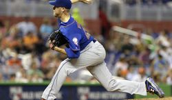 New York Mets' Zack Wheeler pitches to the Miami Marlins in the fifth inning of a baseball game in Miami, Wednesday, May 7, 2014. (AP Photo/Alan Diaz)