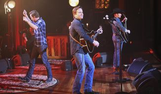 """This image released by ABC shows, from left, Will Chase, Charles Esten and Chris Carmack performing on a special """"Nashville: On the Record,"""" episode at the Ryman Auditorium, in Nashville, Tenn. All original music from the show is released by ABC Studios, Lionsgate and ABC Music Lounge in association with Big Machine Records. Now is a nerve-jangling time for actors and creators of television shows, one week before the biggest broadcast networks reveal their plans for next season. The wait is particularly intense for series, like """"Nashville,"""" that are considered on the bubble between returning and having the plug pulled. A thumbs-down from ABC not only ends a televised soap opera, but a growing music franchise as well. (AP Photo/ABC, Mark Levine)"""